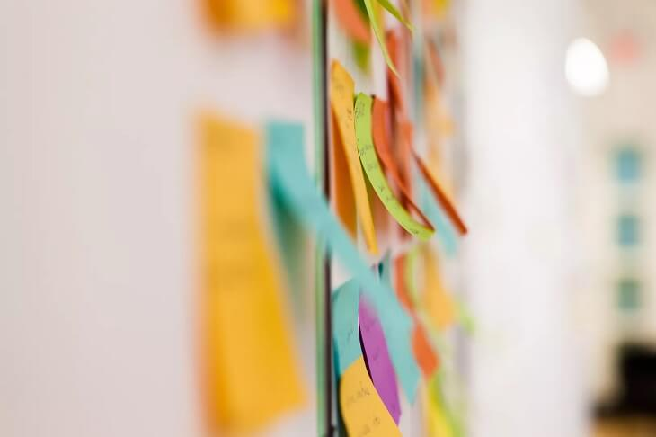 multicolored-sticky-notes-on-whiteboard