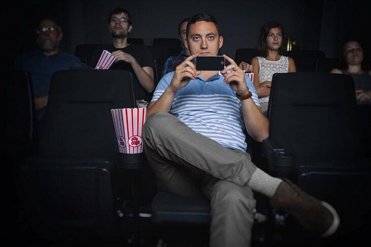 man-illegally-recording-movie-screening